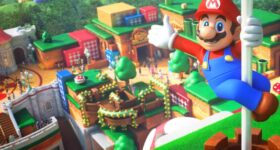 Super Nintendo World, Mario trzymający się flagi i wskazujący otwartą dłonią na znajdujący się za nim park rozrywki