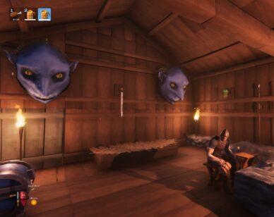 Valheim patch 0.147.3. - screen: postać siedząca w chatce, maski