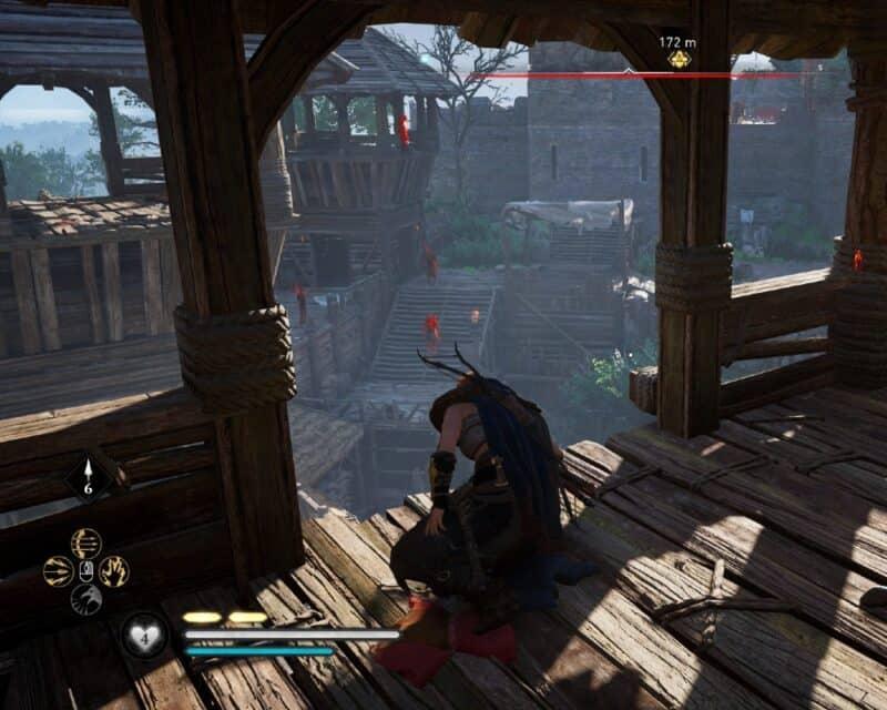 Assassin's Creed Valhalla wyzwanie mistrzowskie, na obrazku damska Eivor siedząca na najwyższym piętrze wieży strażniczej, obok niej zwłoki zabitego strażnika, przed nią dalsze mury zamku i widoczni na nich strażnicy