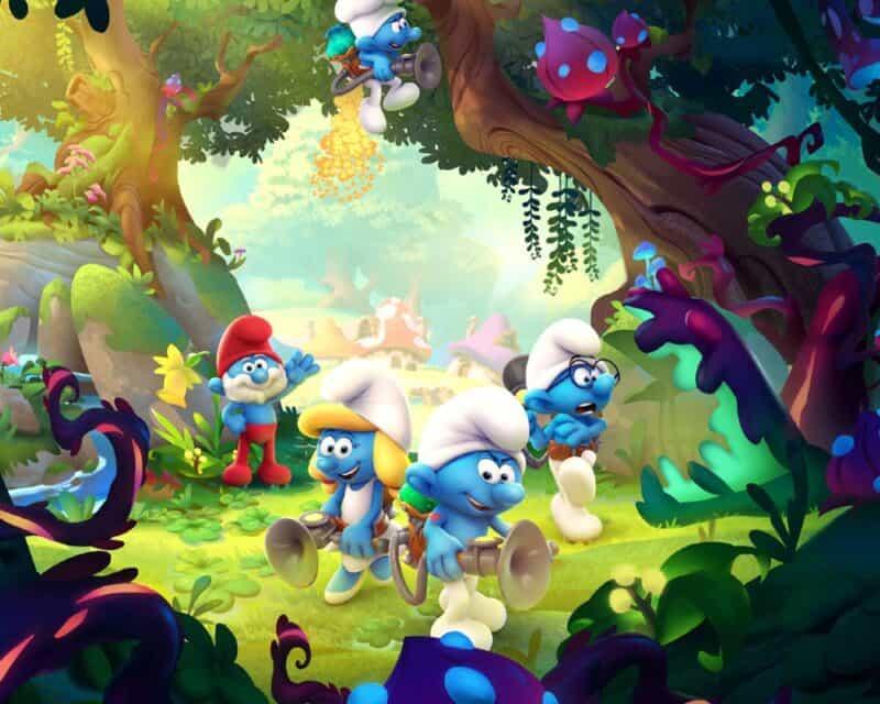Na środku obrazka z gry The Smurfs Mission Vileaf widzimy grupę smerfów , jeden stoi z przodu w białej czapeczce, za nim Smerfetka z żółtymi włosami, pod drugiej stronie smerf w okularach, a na dalszym planie Papa Smerf z czerwonym kapeluszem i spodniami, post przedstawia zwiastun gry